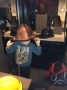 trying out a firefighters hat of long ago